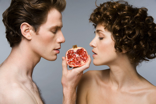 Couple Eating Pomegranate --- Image by © Robert Recker/Corbis